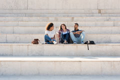 Group of students in Campus. Group of students sitting on school stairs Royalty Free Stock Photography