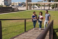 Group of students in Campus. Group of students walking on school campus Stock Photos