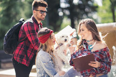 Group Of Students Chatting Together Outdoors Stock Photos