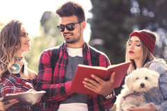 Group Of Students Chatting Together Outdoors Stock Images