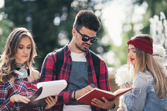 Group Of Students Chatting Together Outdoors Royalty Free Stock Photo
