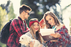 Group Of Students Chatting Together In Park Stock Image