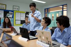 A group of students in a classroom working together on an exercise Royalty Free Stock Photography