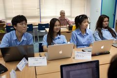 A group of students in a classroom working together on an exercise Stock Photo