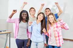 Group of students clench their fists. And raise their arms out of joy Royalty Free Stock Images