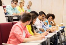 Group of students with coffee writing on lecture Royalty Free Stock Photo