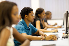 Group students computer. Group of african university students in computer room stock image