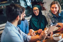 Students of diverse ethnic learning at home. Learning and preparing for university exam. Group of students of diverse ethnic learning at home. Learning and royalty free stock photos