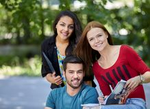 Group of students doing homework outside Stock Photography