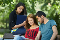Group of students doing homework outside Stock Image