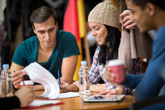 Group of students exchanging ideas during learning Stock Image