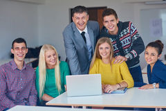 Group of students getting suppport from teacher Royalty Free Stock Photography
