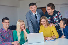 Group of students getting suppport from teacher Stock Photography