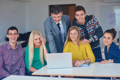 Group of students getting suppport from teacher Royalty Free Stock Photo