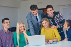 Group of students getting suppport from teacher Stock Photo