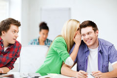 Group of students gossiping at school Stock Photography