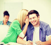 Group of students gossiping at school Royalty Free Stock Photos