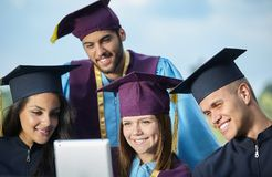 Group of students in graduation gowns and caps Stock Photo