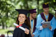 Group of students in graduation gowns. Graduation: Group of Students Look to the Future Royalty Free Stock Image