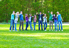 Group of students on the grass Stock Photos