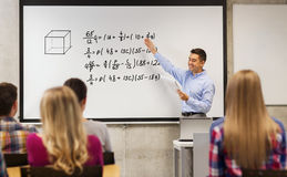 Group of students and happy teacher at white board Royalty Free Stock Images