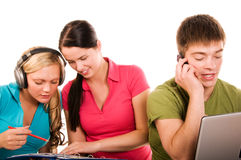 Group of students having fun, doing home work Stock Photos