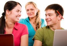 Group of students having fun, doing home work. (isolated on white Royalty Free Stock Photo