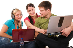 Group of students having fun, doing home work Stock Photo