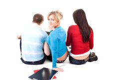 Group of students having fun, doing home work. (isolated on white Royalty Free Stock Photos