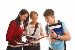 Group of students having fun, doing home work (iso. Lated on white royalty free stock image