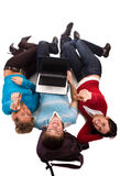 Group of students having fun, laying on white. Doing home work stock image