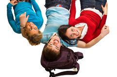 Group of students having fun, laying on white. Doing home work royalty free stock images