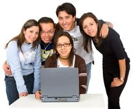 Group of students on a laptop Stock Photos