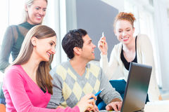 Group of students learning at college. With laptop computer Stock Photo