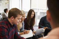 Group Of Students In Library Collaborating On Project Royalty Free Stock Images