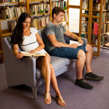 Group of students in library reading books - study group Stock Photography