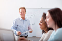 Group of students listening to their teacher Royalty Free Stock Photos