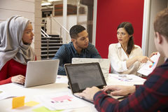 Group Of Students Meeting For Tutorial With Teacher Stock Images