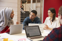 Group Of Students Meeting For Tutorial With Teacher royalty free stock photo