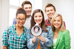 Group of students with megaphone at school. Education concept - group of students with megaphone at school royalty free stock photography