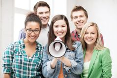 Group of students with megaphone at school Stock Photo