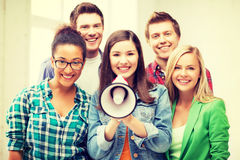 Group of students with megaphone at school Royalty Free Stock Photo