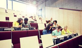 Group of students with notebooks at lecture hall royalty free stock photos