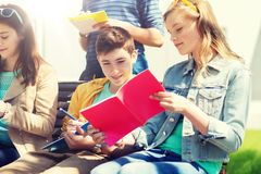 Group of students with notebooks at school yard royalty free stock photos
