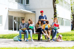 Group of students with notebooks at school yard Stock Photos