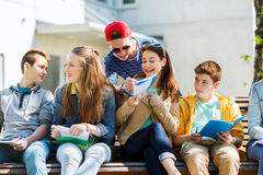 Group of students with notebooks at school yard stock image