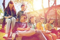 Group of students with notebooks at school yard Royalty Free Stock Images