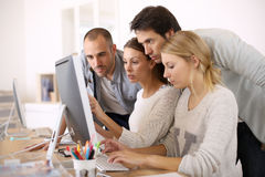Group of students at office working Stock Photo