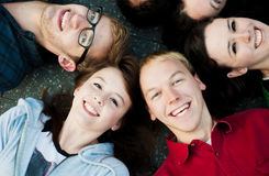 Group of Students Outside. On the ground smiling Royalty Free Stock Photo