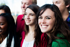 Group of Students Outside. Group of students outsdie smiling with focus on one Royalty Free Stock Image